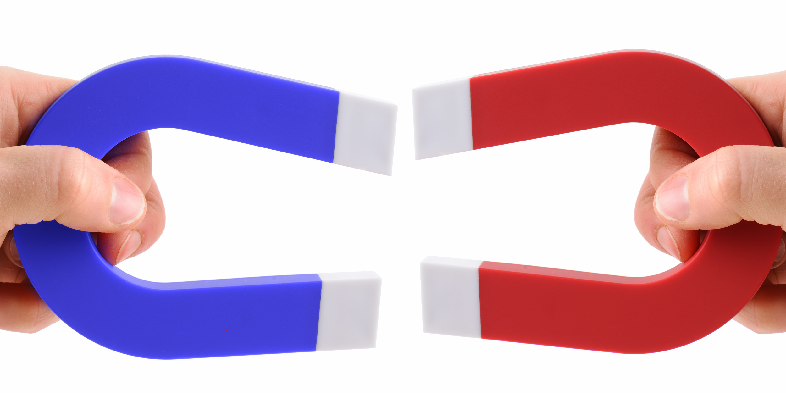 Two magnets demonstrate how opposites attract