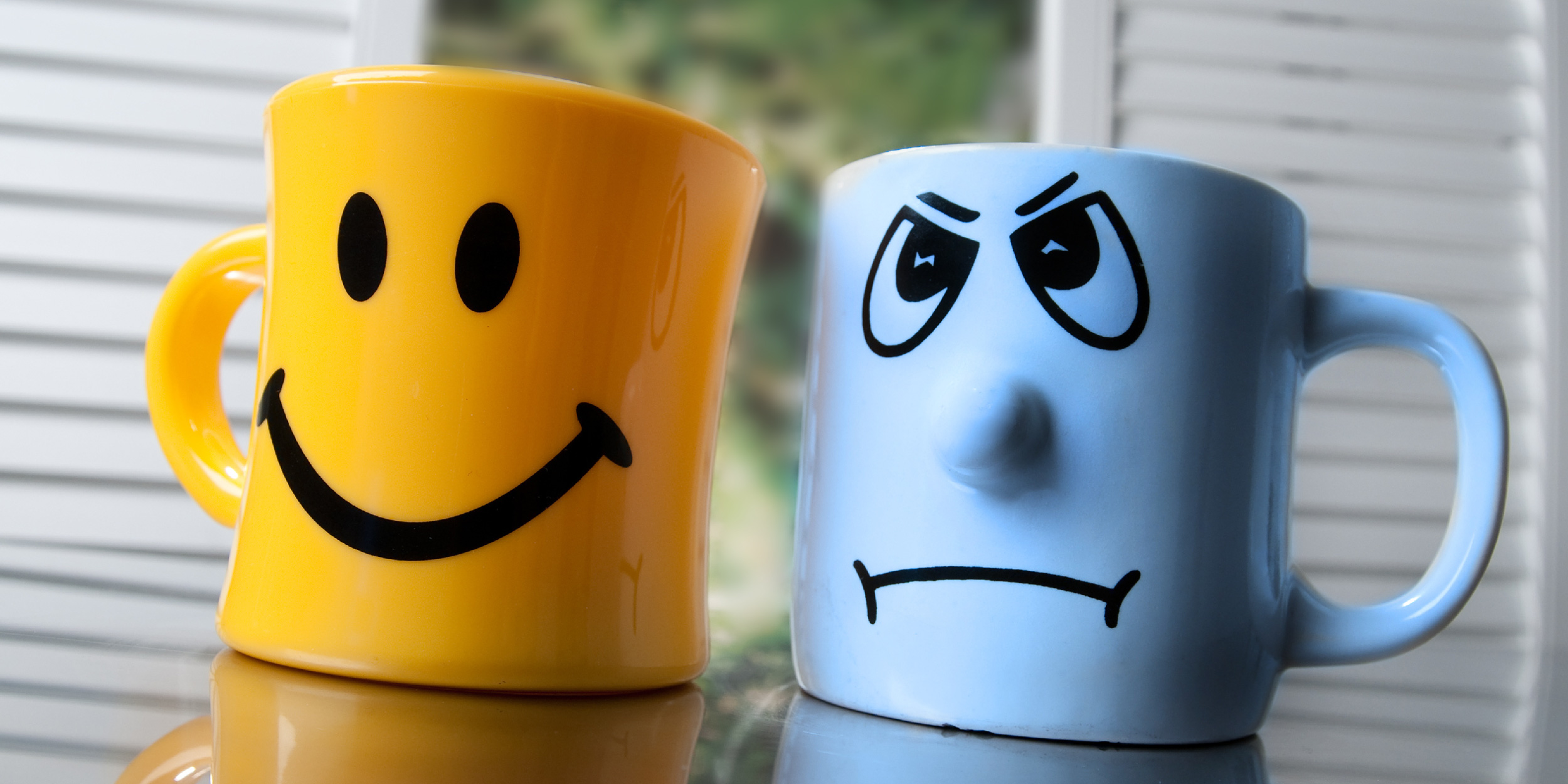 Happy and Sad Mugs demonstrate how an executive coach can improve employee outlook and success